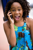 African girl talking on cellphone — Stock Photo