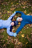 Smiling girls laying on ground — Stock Photo