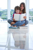 Teenage sister with brother and book — Stock Photo