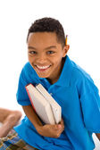 Teenage boy holding textbooks — Stock Photo