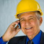 Businessman wearing hardhat — Stock Photo