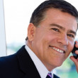Smiling businessman on cell phone — Stock Photo