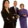 Businesswomen with senior businessman — Stock Photo