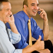 Two Businessmen on cellphones gesturing — Stock Photo #36340837