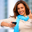 Beautiful female giving thumbs up — Stock Photo