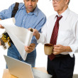 Stock Photo: Architect and building Contractor Studying Blueprints