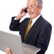 Happy Businessman Holding a Laptop — Stock Photo