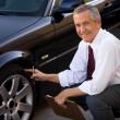 Car Salesman Checking Car's Tire — Stok fotoğraf