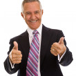 Senior businessman pointing at camera with thumbs — Stock Photo