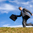 Stock Photo: Blurred motion businessmrunning
