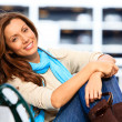 Young female sitting on bench — Stockfoto #36341357