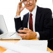 Stock Photo: Senior businessman sitting at desk