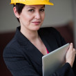Stock Photo: Womwearing hardhat