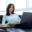 Stock Photo: Young female with laptop