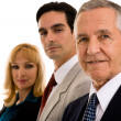 Businessmen with businesswoman — Stock Photo