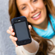 Stock Photo: Female holding cellphone