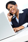 Businesswoman on mobile phone with laptop — Stock Photo