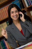Businesswoman on cellphone at office — Stock Photo