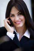 Mid adult businesswoman on cellphone — Stock Photo