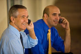 Two Businessmen on cellphones — Stock Photo