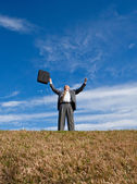 Senior man with arms outstretched in air — Stock Photo