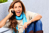 Shocked Woman talking phone — Stockfoto