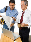 Architect and building Contractor Studying Blueprints — Stock Photo