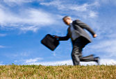 Blurred motion businessman running — Stock Photo