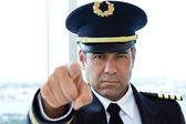 Airline pilot pointing finger towards camera — Stock Photo