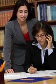 Businesswomen working at desk — Stock Photo