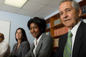 Multi-ethnic group sitting at business meeting — Stock Photo