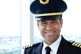 Smiling airline pilot — Stock Photo