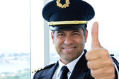 Airline pilot giving thumbs up — Stock Photo