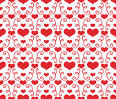 Seamless pattern with hearts and swirls — Stock Vector