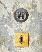 Two old light switches on a wall — Stock Photo