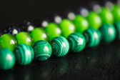 Green and black beads from a stone — Stockfoto