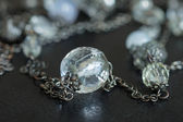 Necklace from a metal and glass beads — Stock Photo