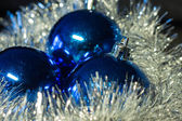 Christmas spheres on a silvery background — Stock Photo