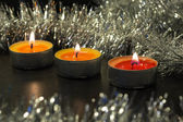 Burning candles and silver decor — Stock Photo