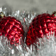 Christmas tree decorations in the form of cones on a silvery background — Stock Photo