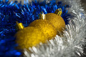 Gold Christmas spheres among a silver and blue decor — Stock Photo