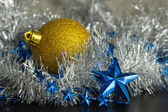 Gold sphere and chain of blue stars — Stock Photo