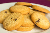 Small group of round cookies on a plate — Stock Photo