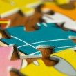 Stock Photo: Scattered slices of puzzle close up