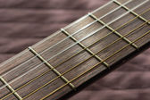 Part of an acoustic guitar with strings — Stok fotoğraf