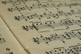 Page turn in an old music book close up — Stock Photo