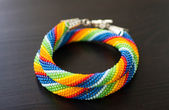 Knitted necklace from beads of a rainbow colors — Stock Photo