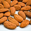 Almonds handful background — Stock Photo