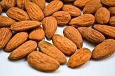 Almonds handful background — Stock Photo