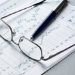 Stock Photo: Pen, business chart and glasses